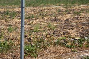 Tension wire on fence posts