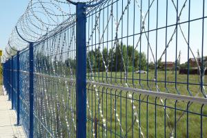 Welded panel fence, Piranha barbed mesh and Kayman concertina barrier