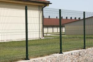 A metal fence from welded grid on a tape foundation